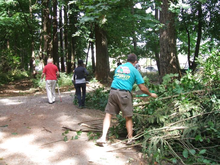 Volunteers clear brush, improve visibility
