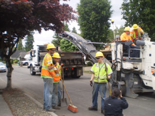 "This summer you'll be seeing more ""Road Work Ahead"" signs in your neighborhood. City of Gresham to repair five hundred street sections, now through Fall 2011"